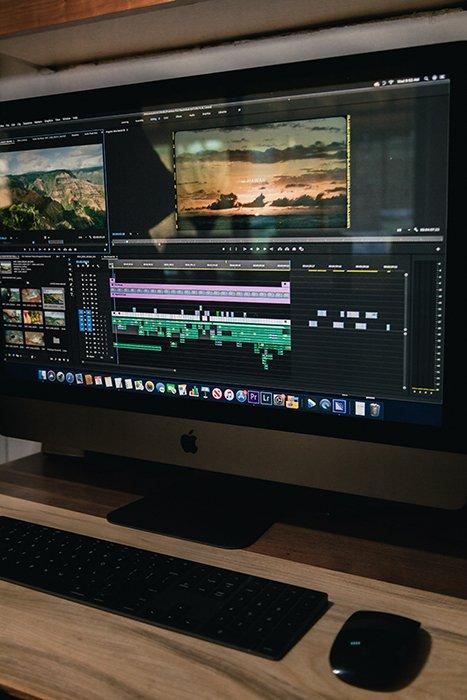 Photo of a desktop computer on an editing screen