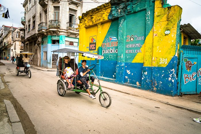 Tuktuk bikes on a dusty street
