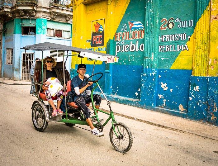 A tuktuk bike on a dusty street