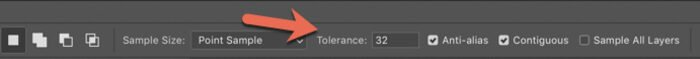 A red arrow pointing to the Tolerance selection on Photoshop options bar