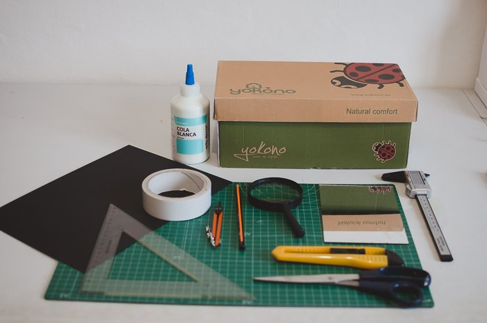 materials for making a smart phone projector including a shoe box, cutting mat, paper, glue and stationary