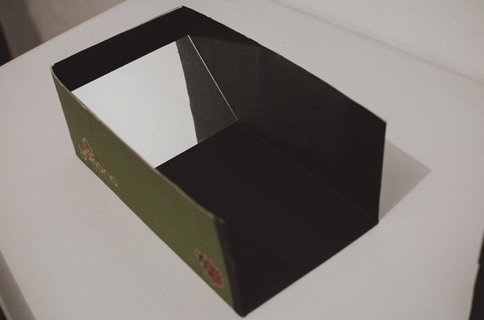 The interior of a DIY smartphone photo projector