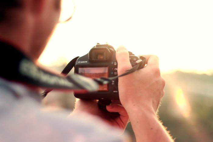 Close-up photo of a guy holding a camera