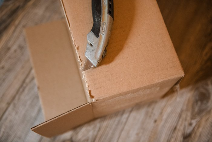 Removing the top of a cardboard boxes to make a softbox