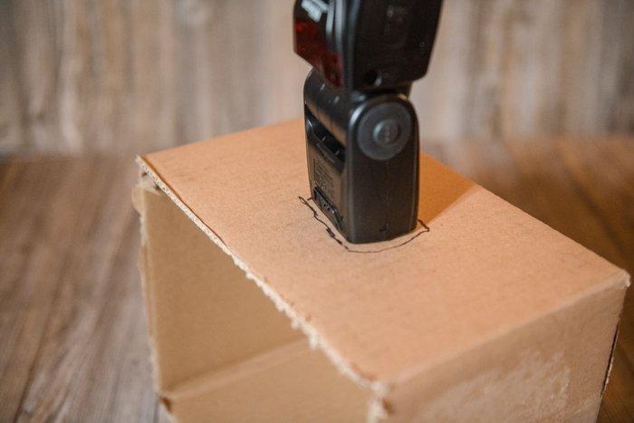 Cutting a cardboard box to make a DIY softbox