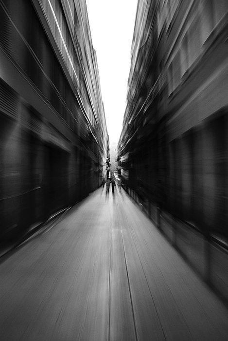 A blurry black and white street scene