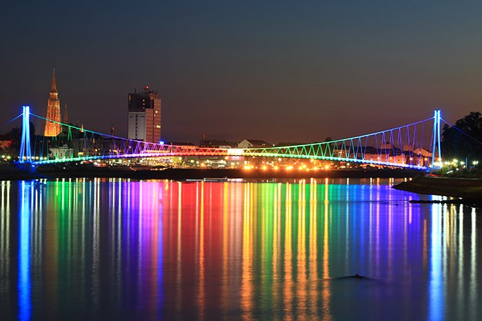 Colorful lights on a bridge at night