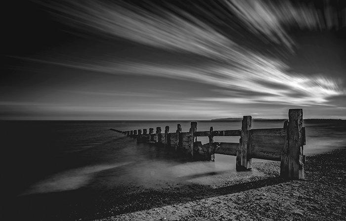 A black and white beach scene