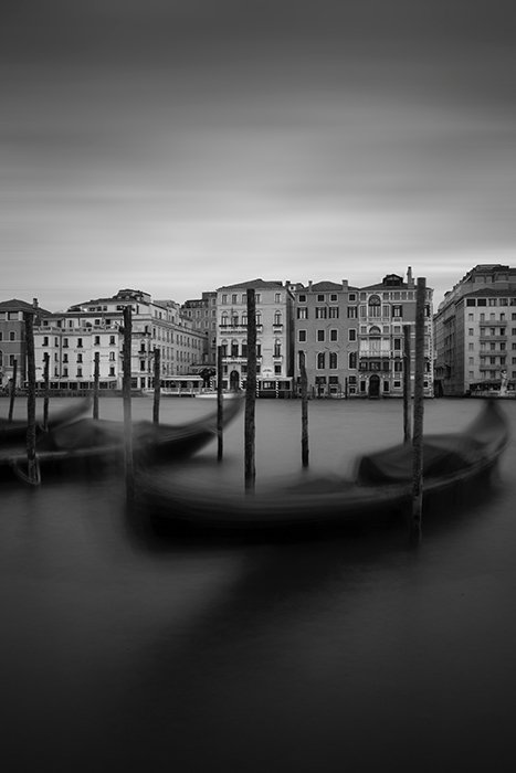 black and white photo of boats in a harbour