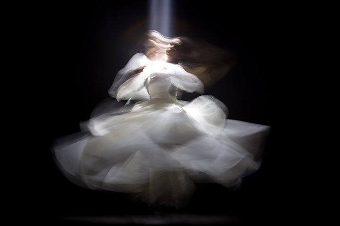 blurry portrait of a girl in white dress