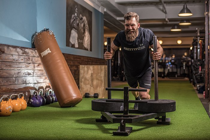 A man working out in the gym for a fitness photoshoot