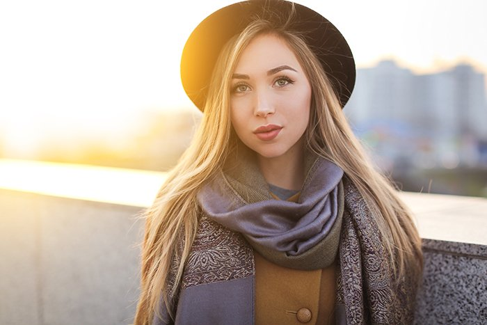 Portrait of a beautiful woman photographed at golden hour.