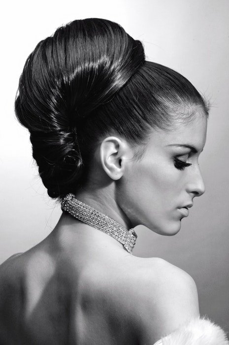 black and white image of woman with formal and elegant hair style