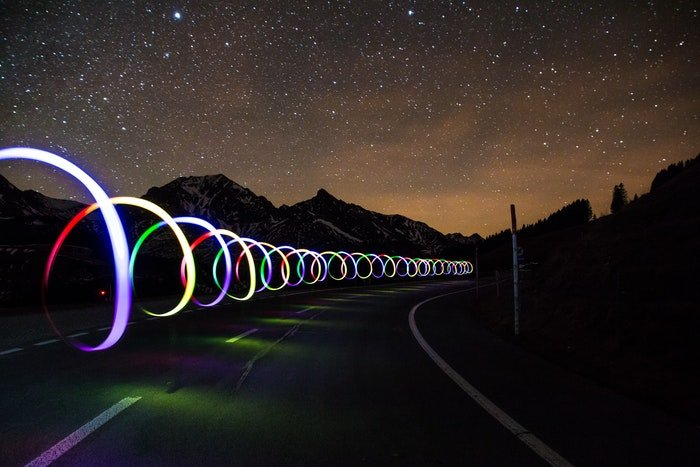 A long exposure of colorful spiral light painting taken at night