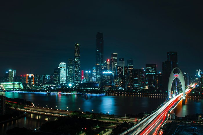 Colored light trails and lights of a sprawling cityscape at night