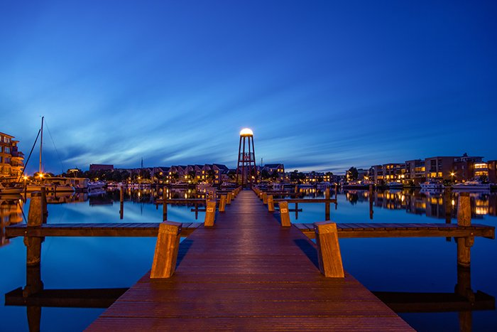 Long exposure time lapse photo of a wooden pier at night