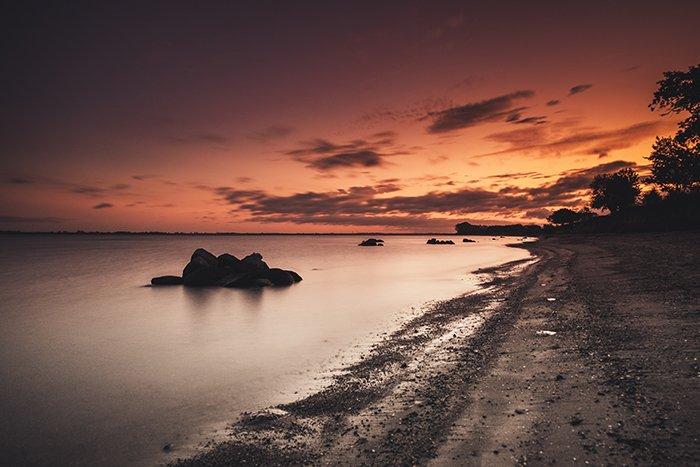 a beach at evening time