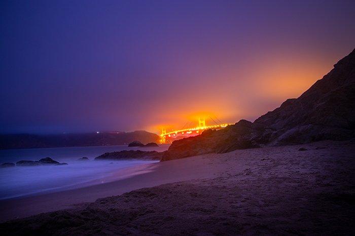 a beautiful beach in low light