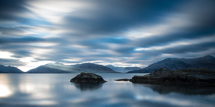 long-exposure image of a lake at evening time