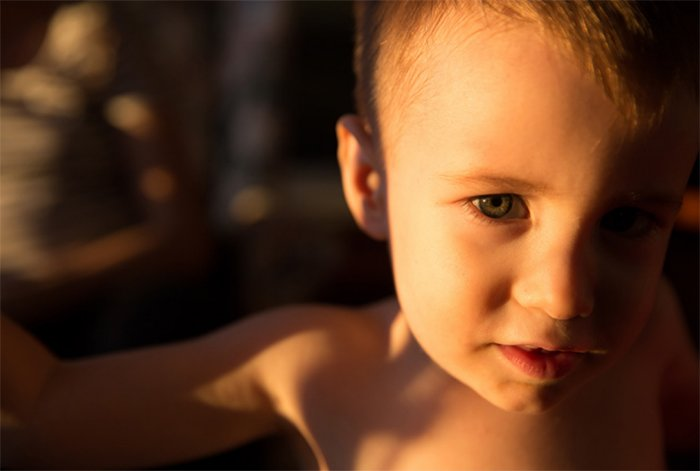 Shadowy portrait of a young boy