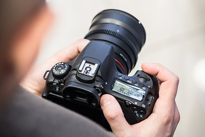 Overhead view of changing a DSLR camera settings