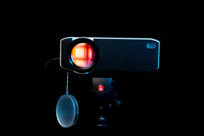 A projector on black background