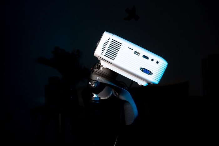 A digital projector on black background