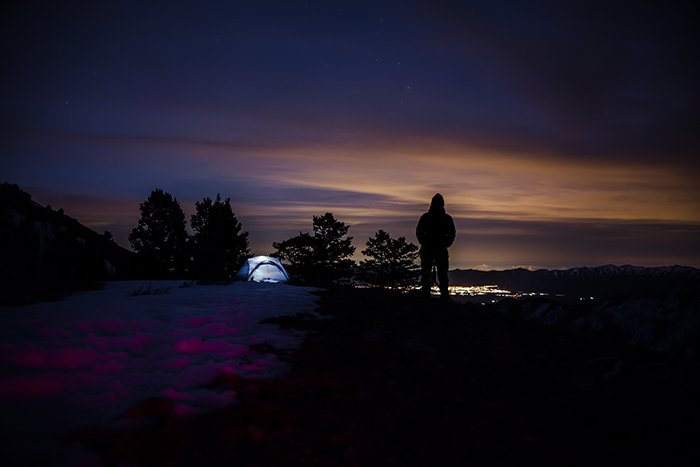 A camper watching the night sky