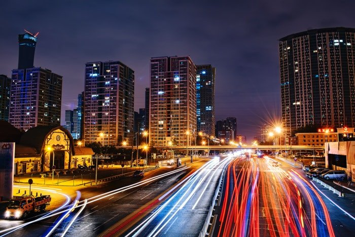 Long exposure shot of a cityscape and light trails at night