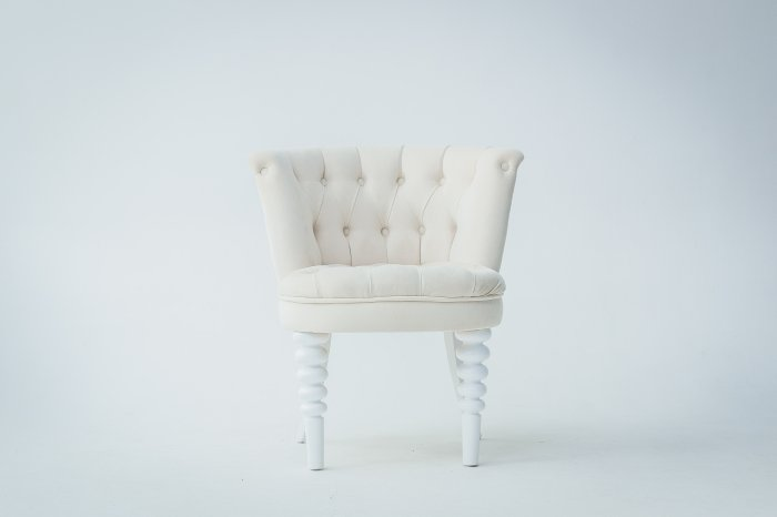 Classy white chair on white background