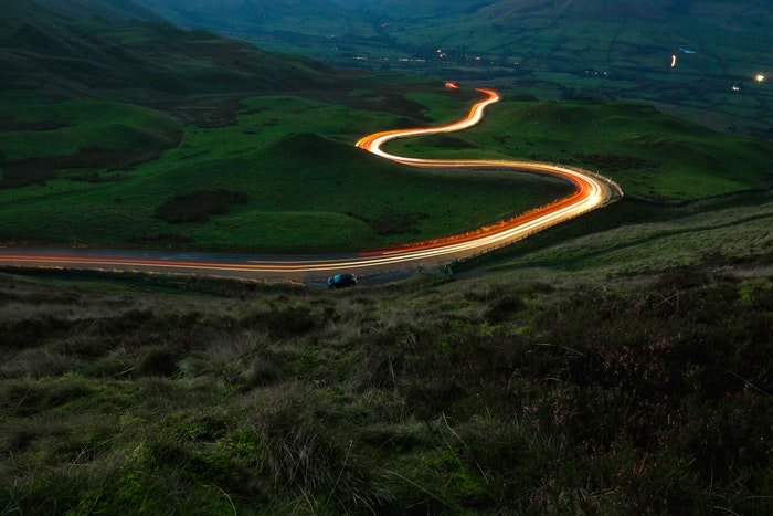 Long exposure of light trails on a winding road