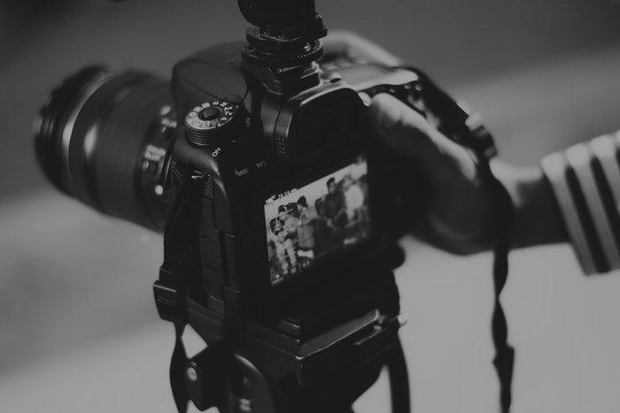 Adjusting camera settings on a DSLR camera