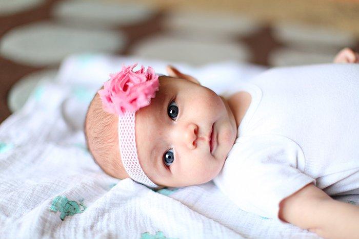 Baby wearing a pink headband.