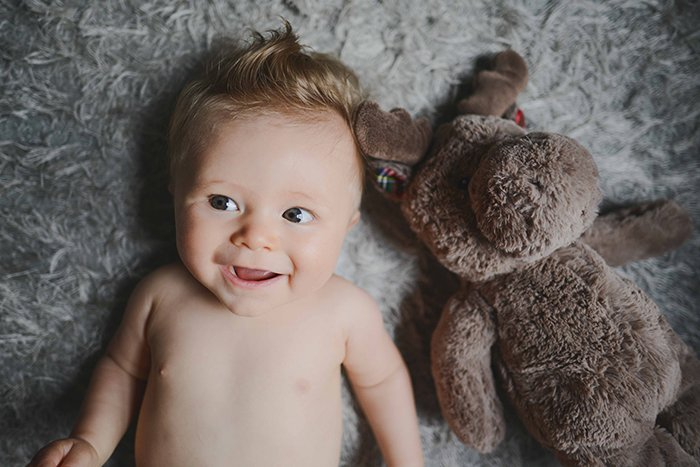 Baby with a stuffed animal.