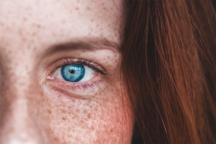 Close up image of a girl's eye with a very shallow depth of field
