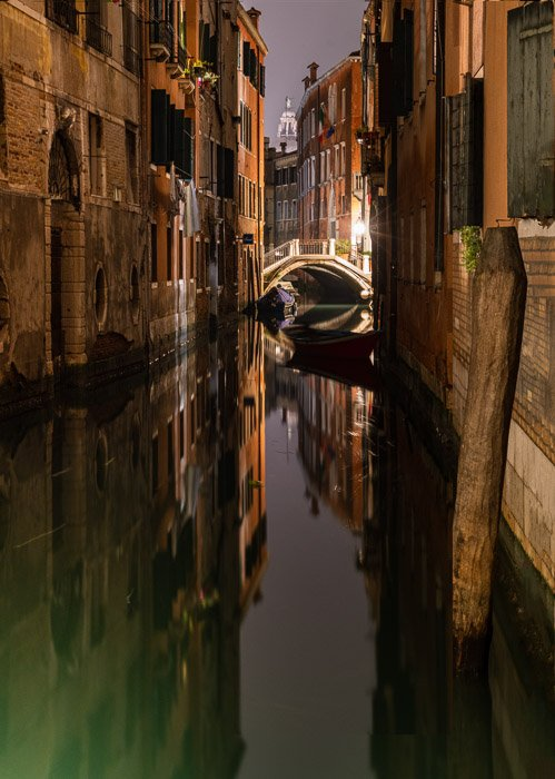 Closer crop of Venetian canal at night.