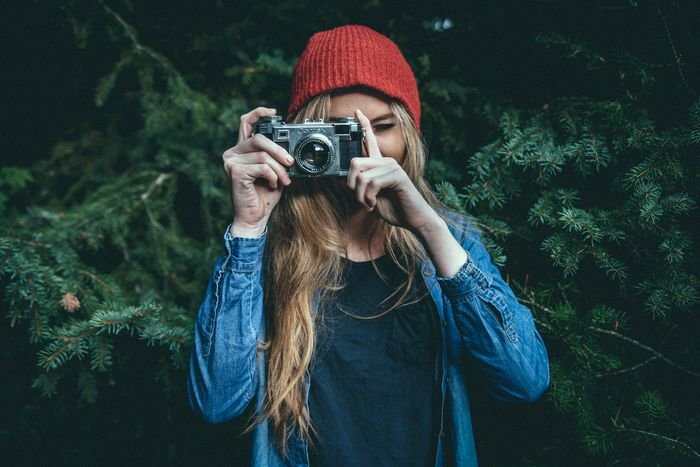 photo of a girl standing outdoors taking a photo