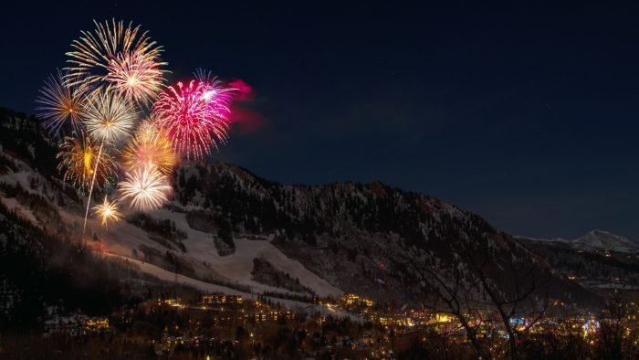 Photo of fireworks exploding on the mountain side