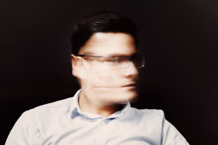 Long exposure portrait of a man with glasses