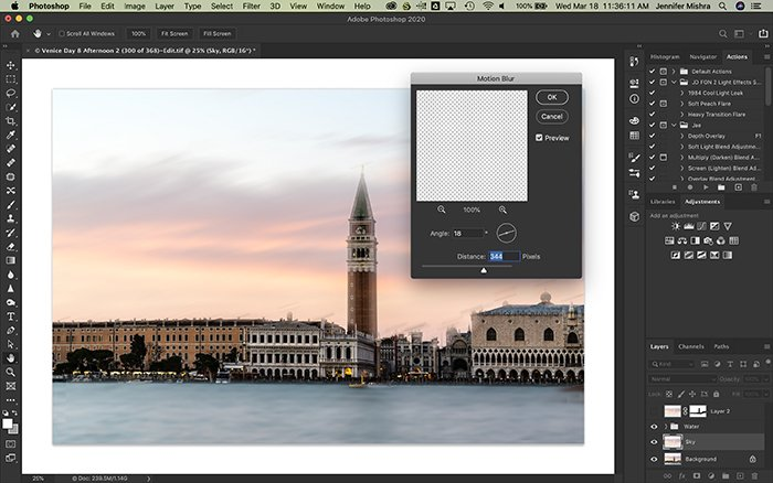 Photoshop screenshot showing sky selected on a new layer and applying 344 pixels of motion blur at an 18 degree angle.