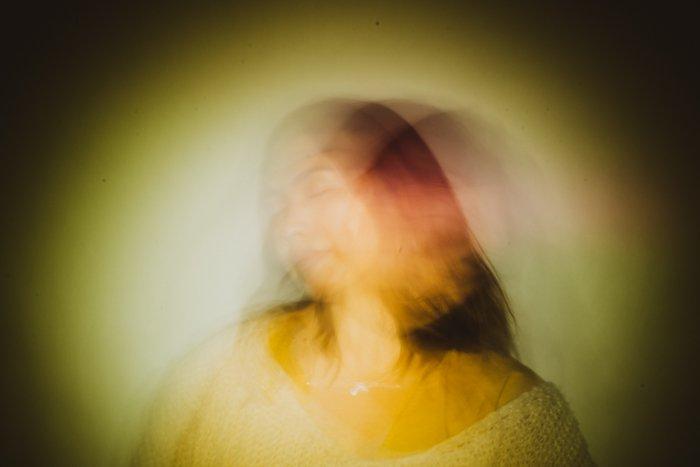 Creative long exposure portrait of a female model in low light