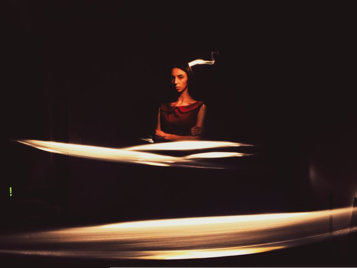 A female model posing in a dark room