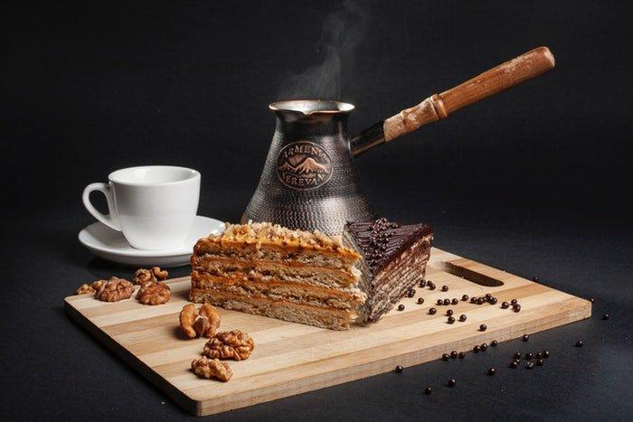 still life photo of marlenka cakes and coffee behind