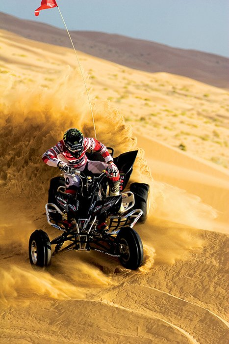 Action shot of a motorsports rider on a beach