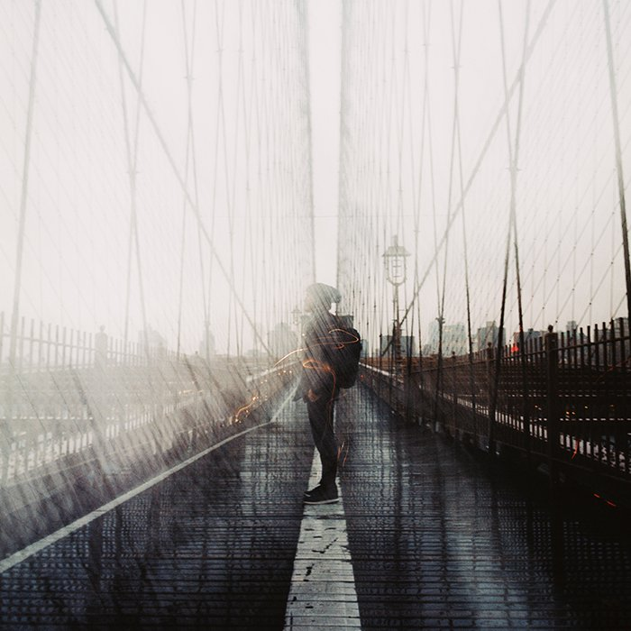 Double exposure effect combined with tilt-shift of a man and the city.