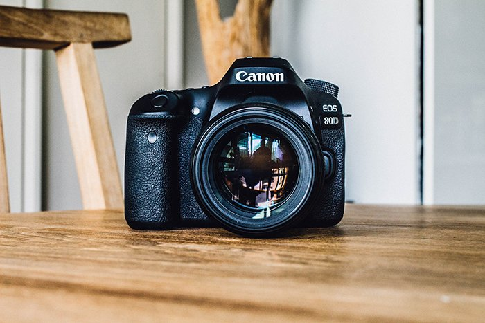 A Canon DSLR digital camera on a table