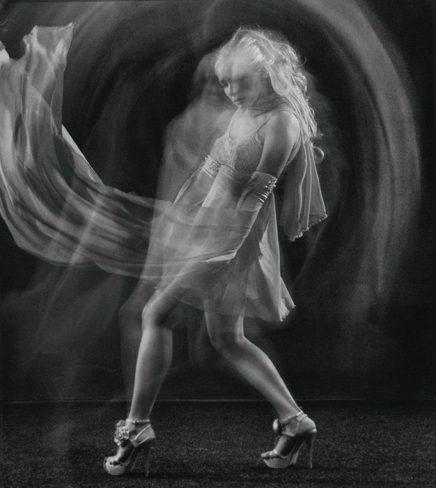 Black and white long exposure of a female dancer onstage