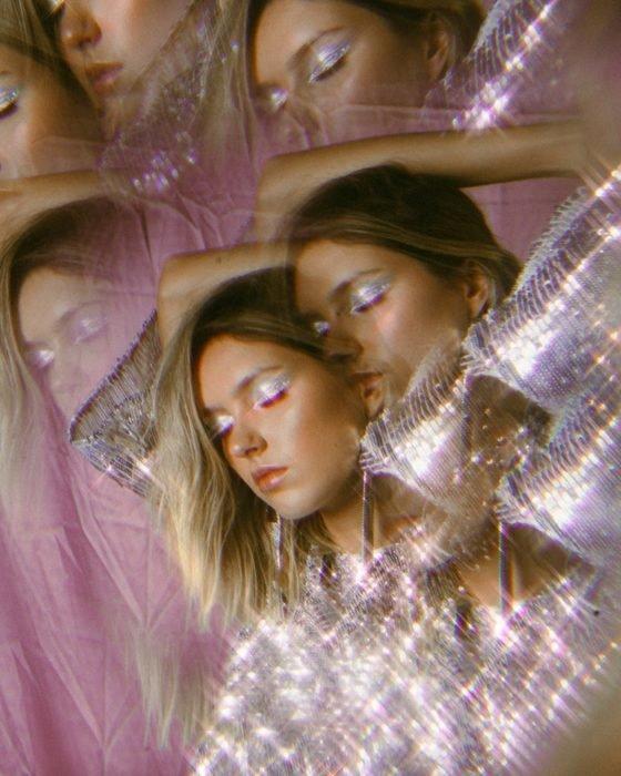 long exposure portrait of a glittery female model