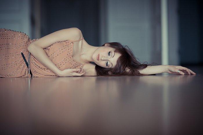Female model lying on a floor