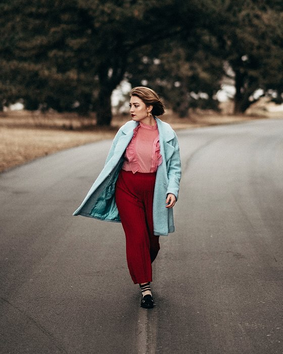 Female model walking in the middle of a road